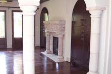 2003 Bellaire showcase home with custom walnut wide-plank wood floors, italian limestone, and hand-carved fireplace mantle.