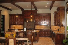 Award Winning Bellaire Showcase Home 2005, custom kitchen cabinetry, floors are reclaimed pavers from French villa, built by Watermark Builders.