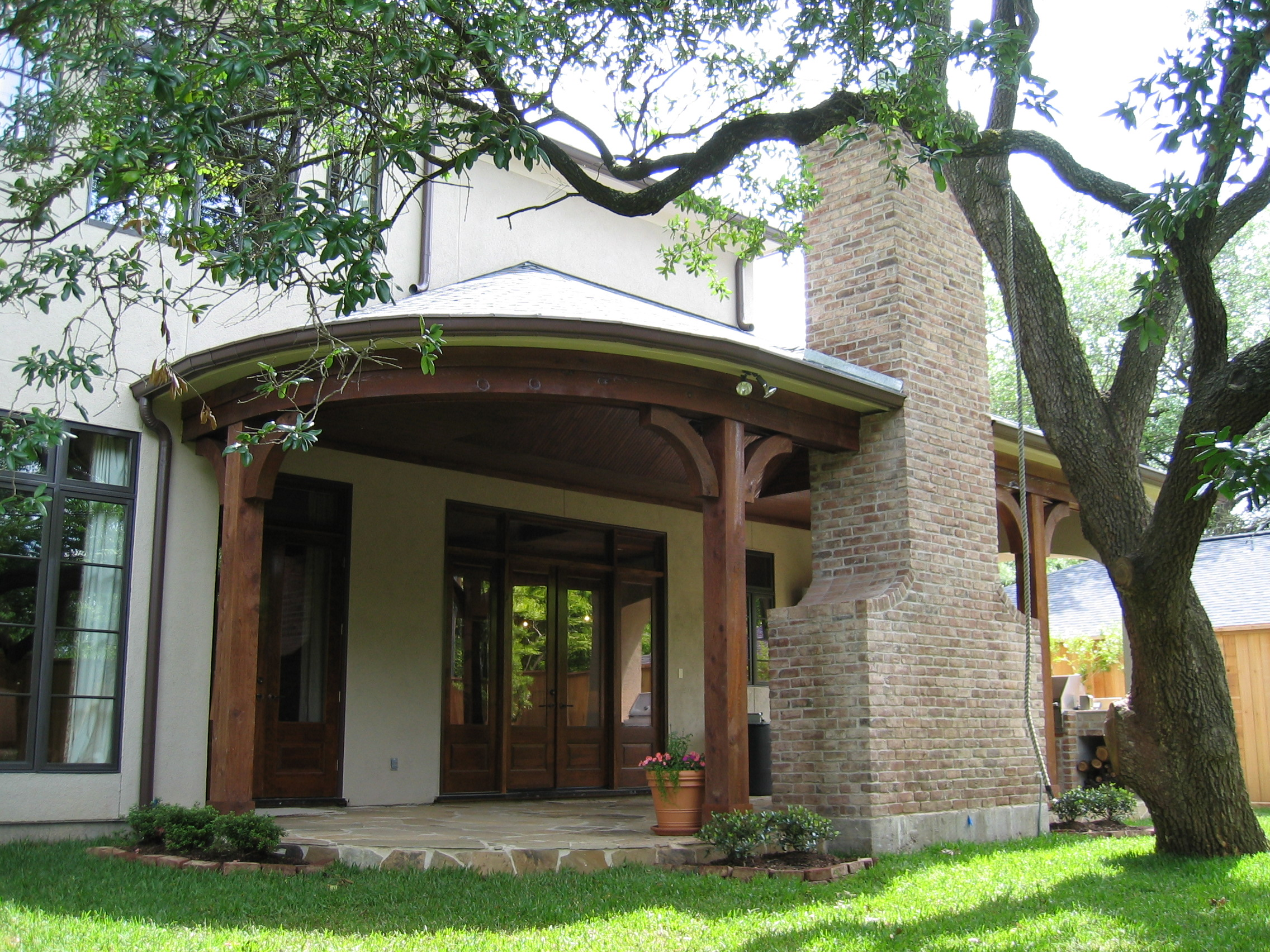 Award Winning Bellaire Showcase 2005, rear porch, cedar beams, outdoor kitchen by Watermark Builders in Houston Texas