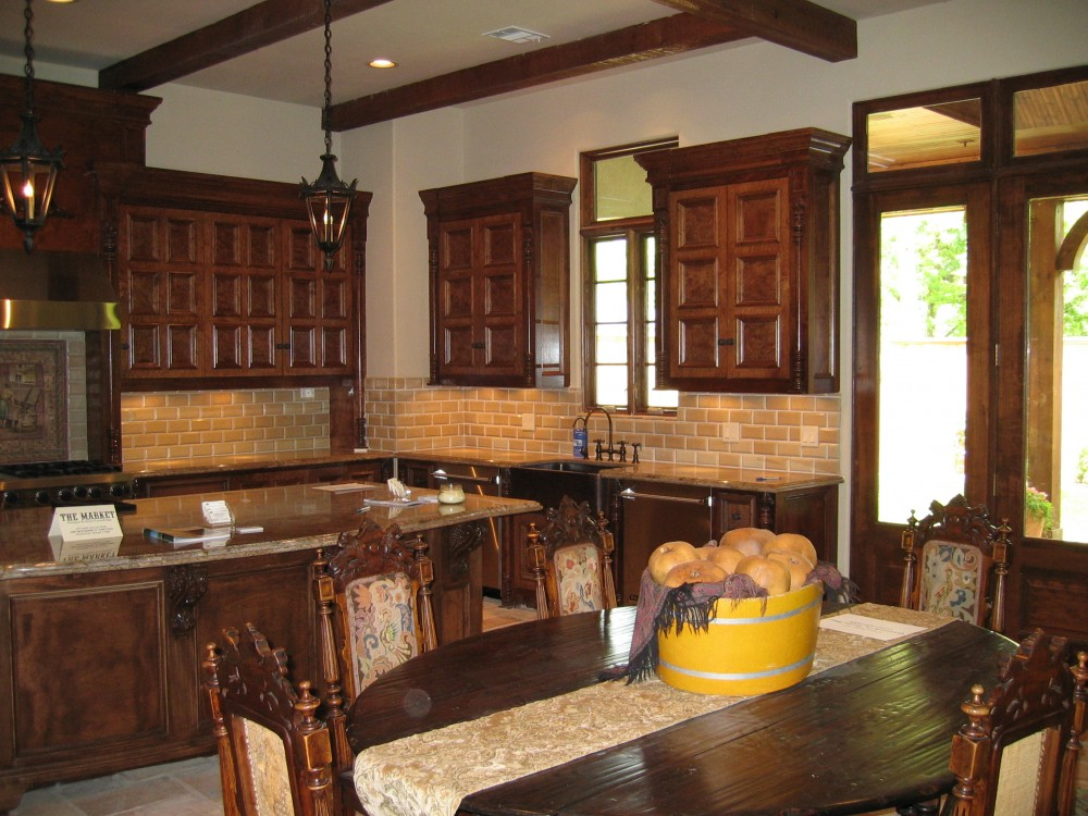 Custom built luxury home kitchen dark wood by award-winning Watermark Builders founded by Gary Lee in Bellaire Texas
