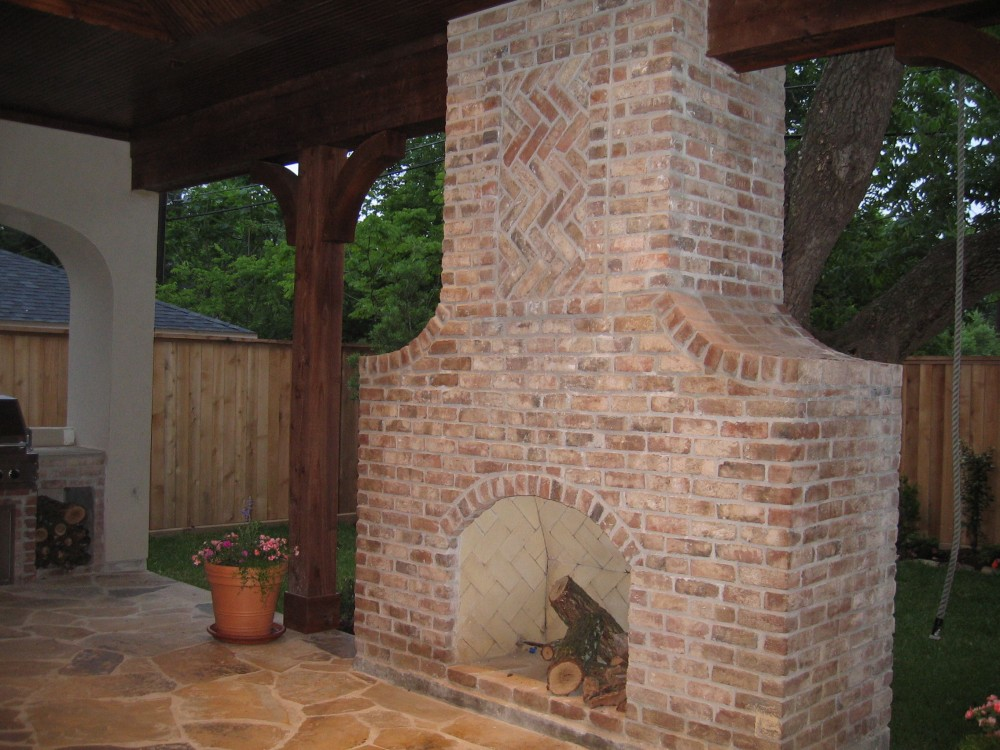 Custom built luxury home outdoor fireplace by award-winning Watermark Builders founded by Gary Lee in Bellaire Texas