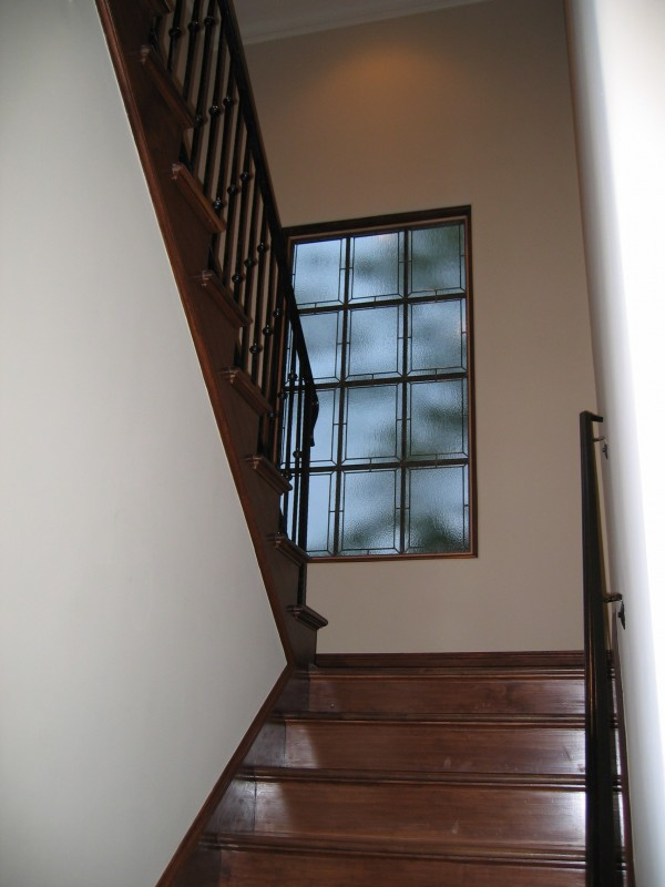 Custom built luxury home stairwell by award-winning Watermark Builders founded by Gary Lee in Bellaire Texas