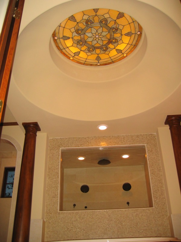Custom built luxury home sunglass sunroof in bathroom by award-winning Watermark Builders founded by Gary Lee in Bellaire Texas