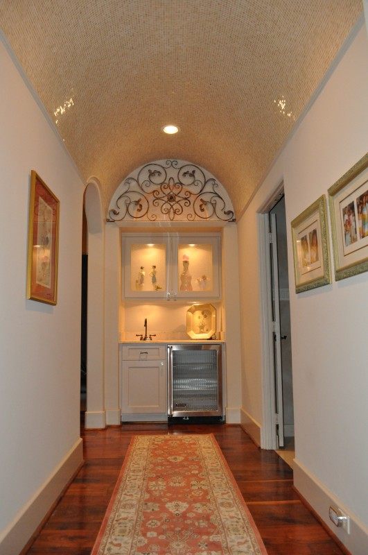 Award-winning Bellaire Texas showcase home for 2003. Hallway to master bath, wide-plank walnut floors with mozaic barrel ceiling.