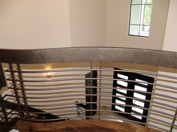Home Builder Watermark Homes with Custom Bronze Stairwell Railing