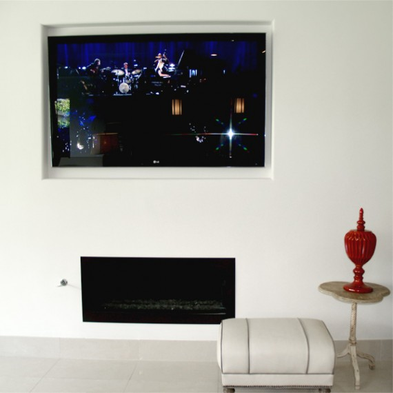Home Builder Watermark Homes with Recessed Custom Tv Mount Gas Glass Bead Fireplace